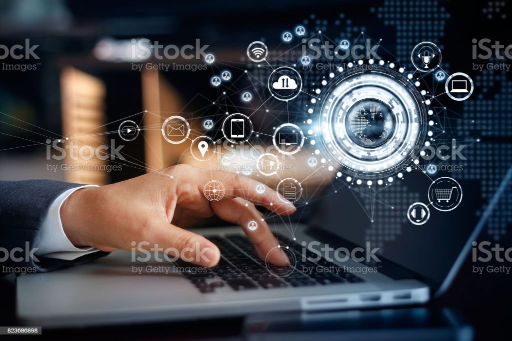 Businessman touching a laptop on global network connection, Omni Channel and communications concept stock photo