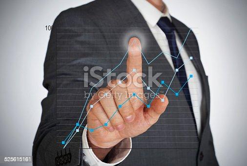 istock Businessman touching a virtual screen 525615161