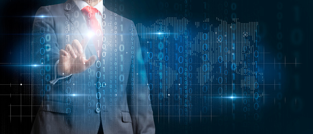 Businessman touching a virtual screen with big data statistics and business analytics concept.