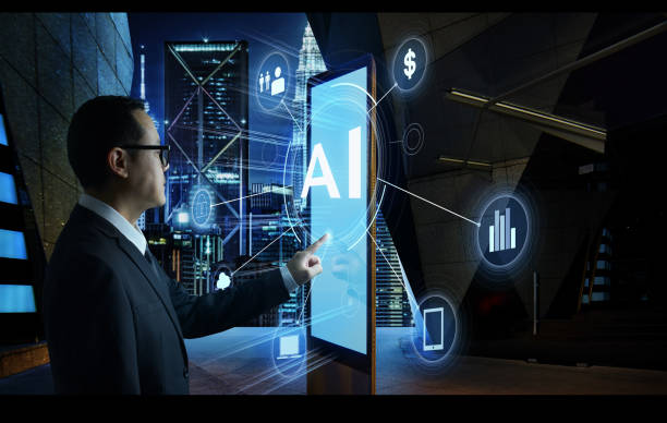 """Businessman touching """"AI"""" word on screen of digital booth with fintech infographic. Hi-tech business concept . Businessman touching """"AI"""" word on screen of digital booth with fintech infographic. Hi-tech business concept . business Malaysia stock pictures, royalty-free photos & images"""