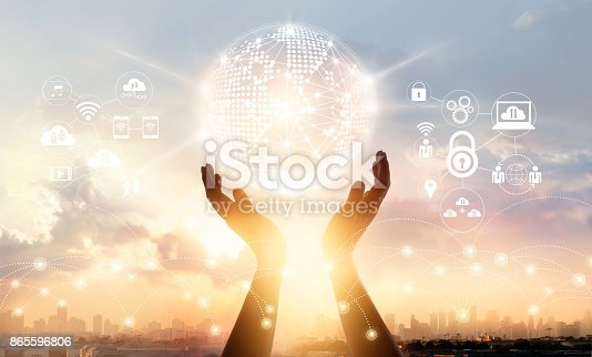 istock Businessman touching circle global network connection and data exchanges worldwide on city sunset background, communication and technology concept 865596806