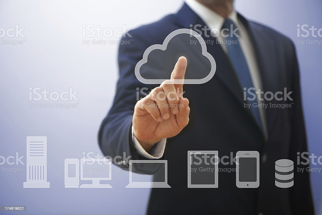 Businessman touching cloud icon on screen royalty-free stock photo