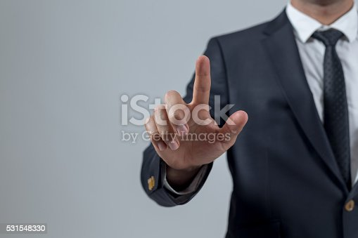 istock Businessman touching concepts in studio 531548330