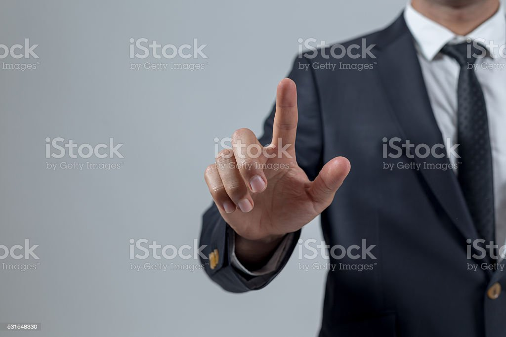 Businessman touching concepts in studio stock photo