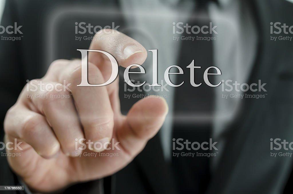 Businessman touching Delete button stock photo