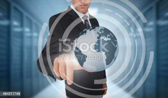 Businessman touching earth on futuristic interface on data center background