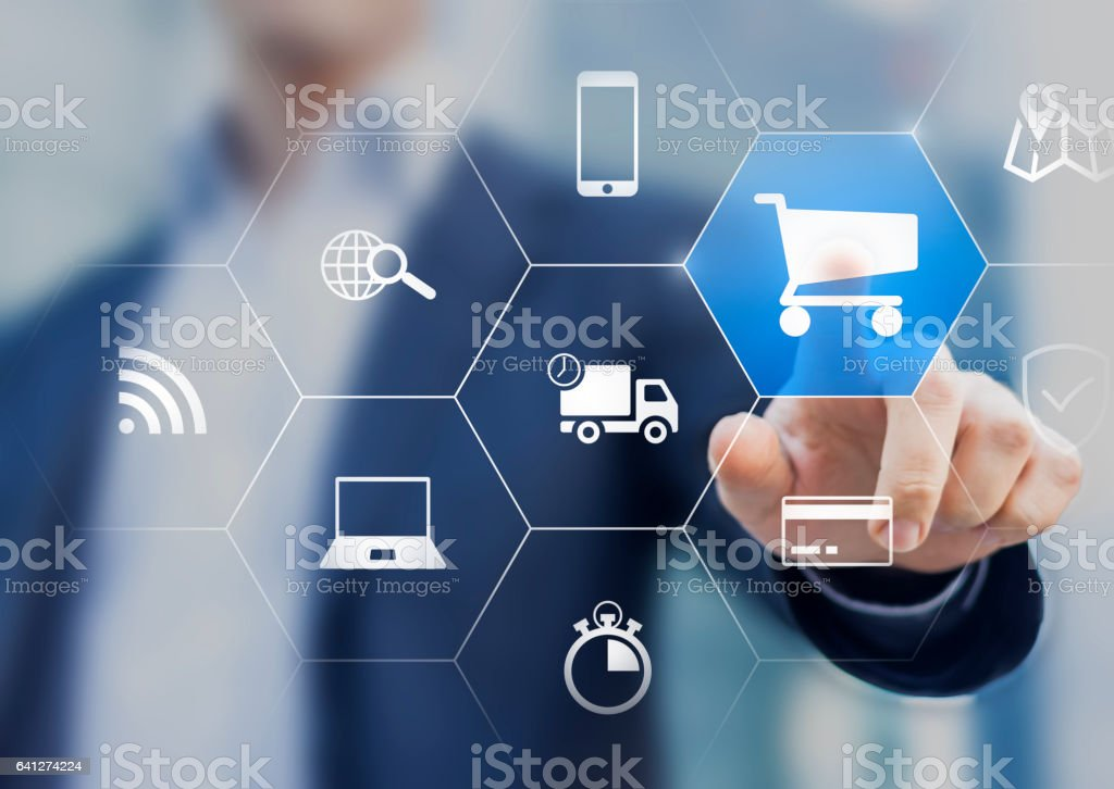 Businessman touching e-commerce button, interface, delivery, shopping, credit card stock photo