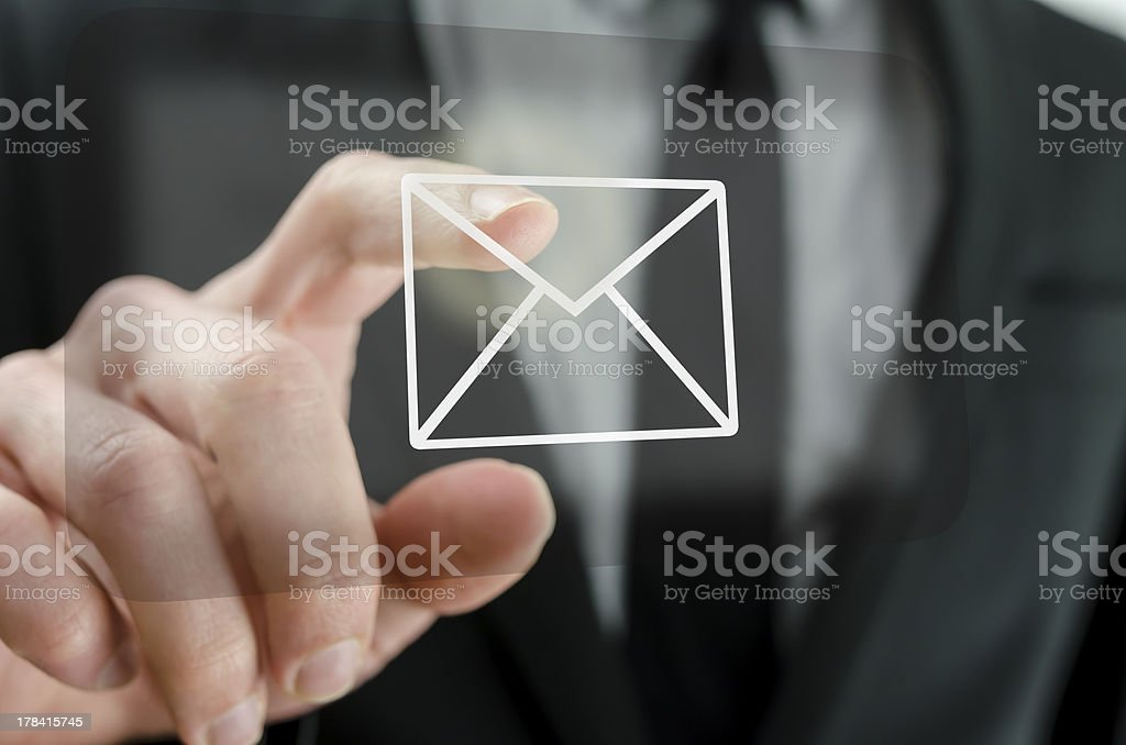 Businessman touching email icon stock photo