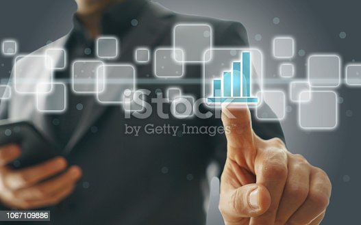 istock Businessman touching financial dashboard 1067109886
