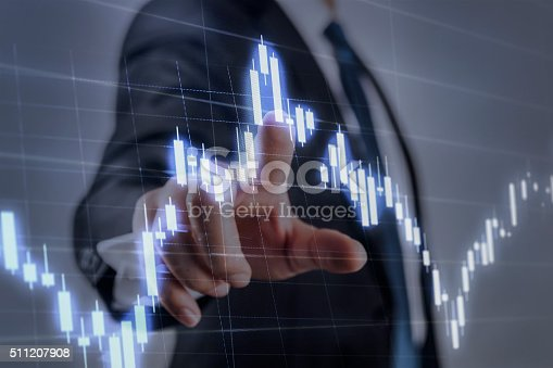 istock Businessman touching financial dashboard 511207908