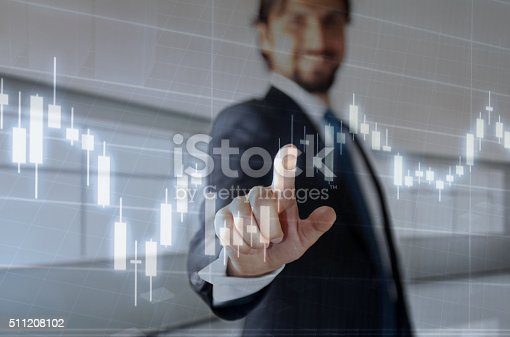 istock Businessman touching financial dashboard 511208102