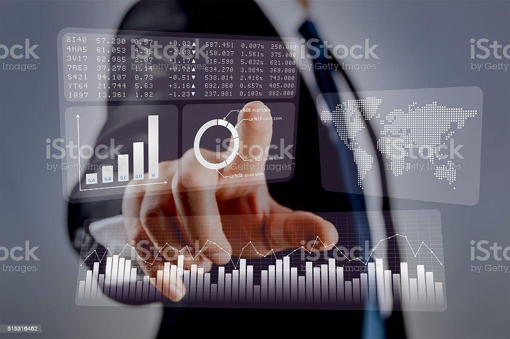 Businessman touching financial dashboard stock photo
