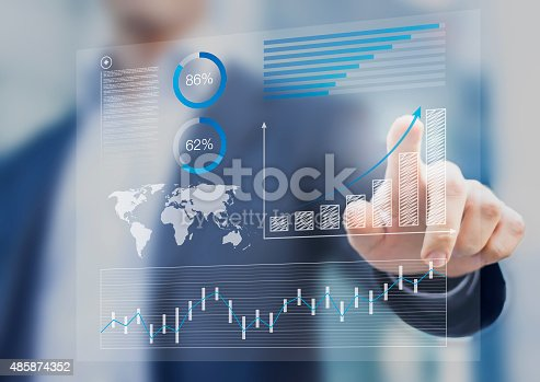 istock Businessman touching financial dashboard with kpi 485874352