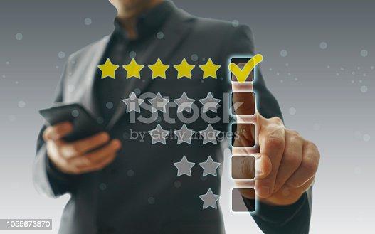 istock Businessman touching five stars 1055673870
