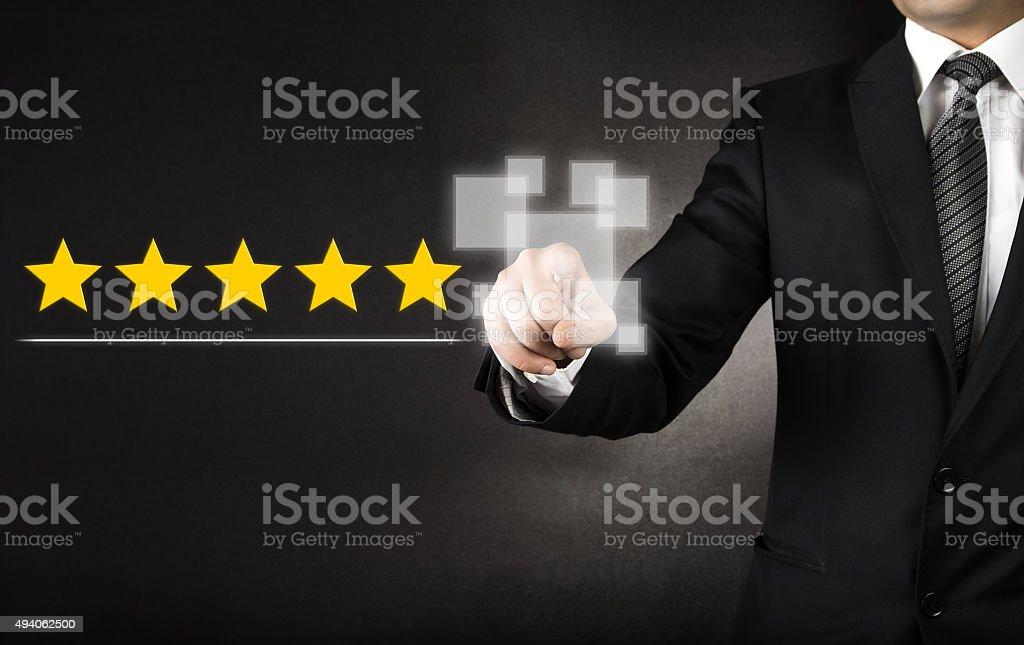 Businessman touching five stars stock photo
