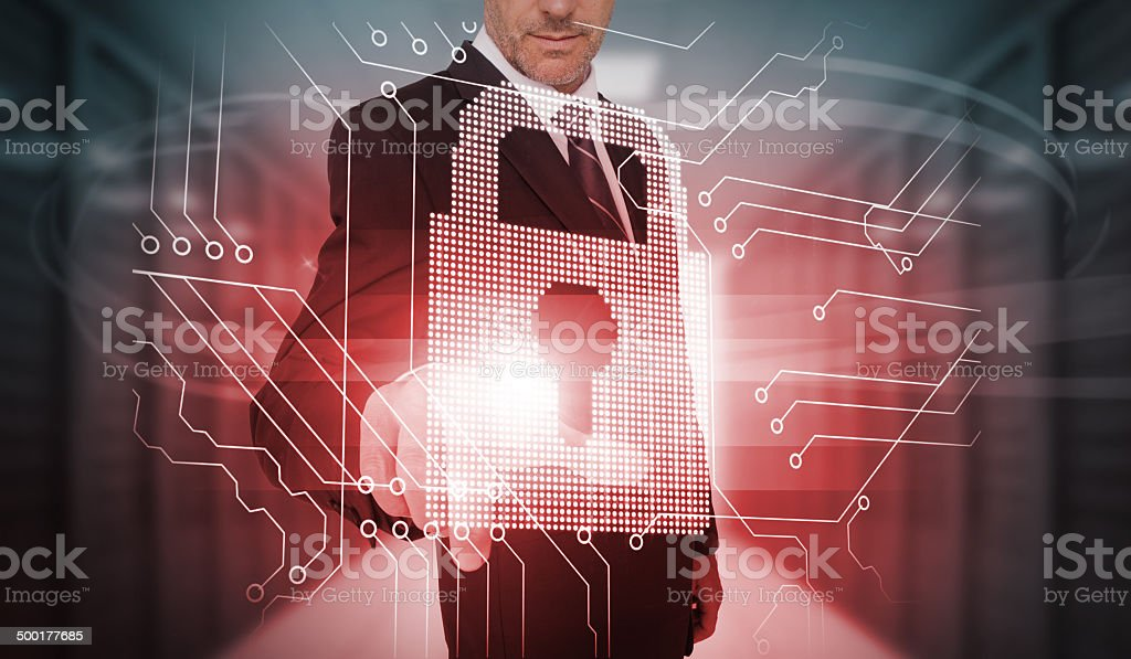Businessman touching futuristic lock and circuit board interface royalty-free stock photo