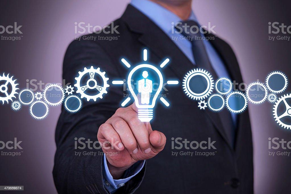 Businessman Touching Human Idea Concept stock photo