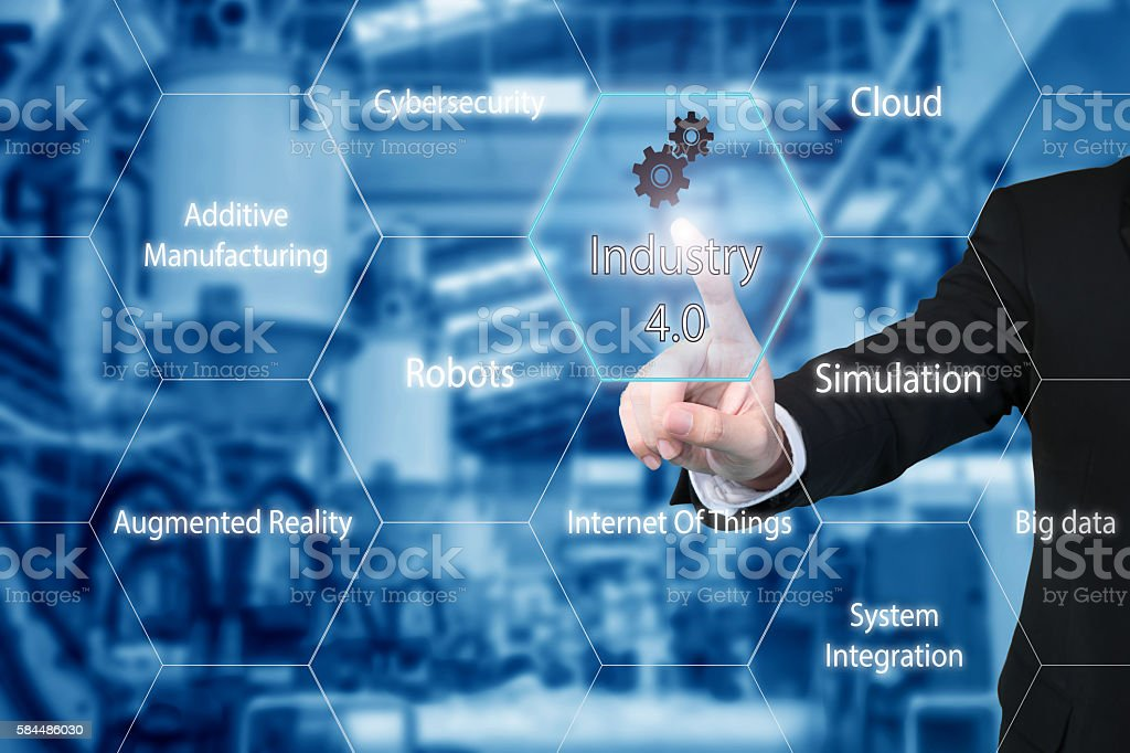 Businessman touching industry 4.0 icon showing data of smart factory. stock photo