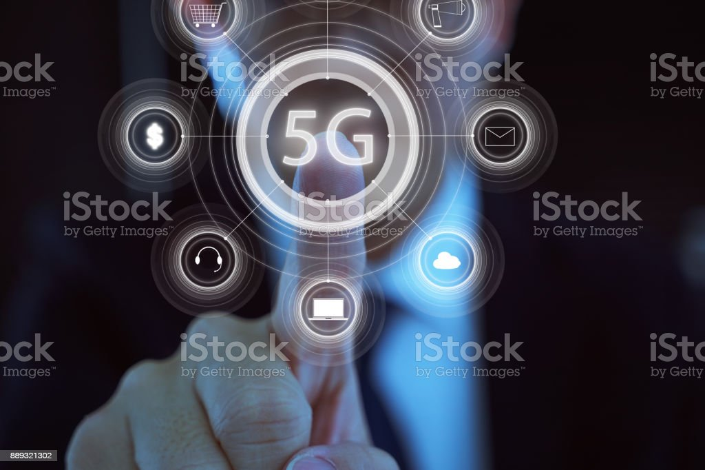Businessman touching internet of things with 5G network wireless systems . stock photo