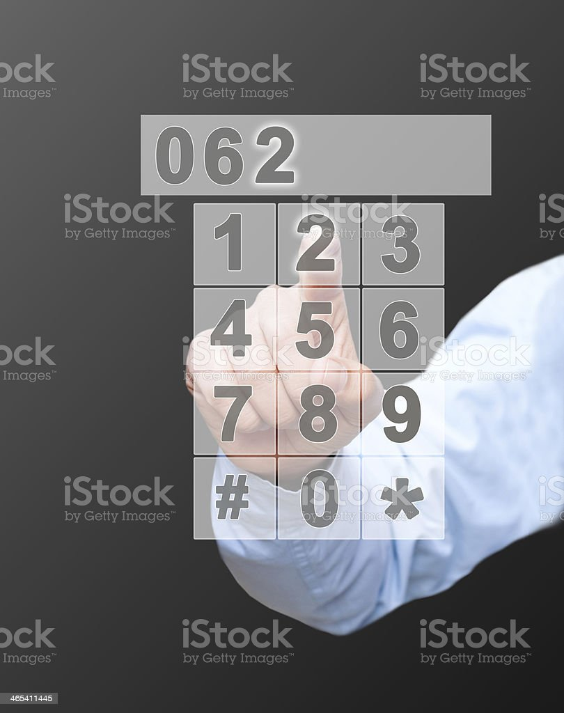Businessman touching keypad on touch screen royalty-free stock photo
