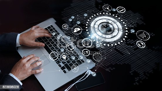 823686896 istock photo Businessman touching laptop on a global network connection, Omni Channel and communications concept 823698028