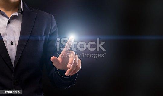 499253490istockphoto Businessman touching lightning button on empty space on black 1165529762