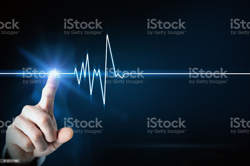Businessman touching line of heartbeating stock photo