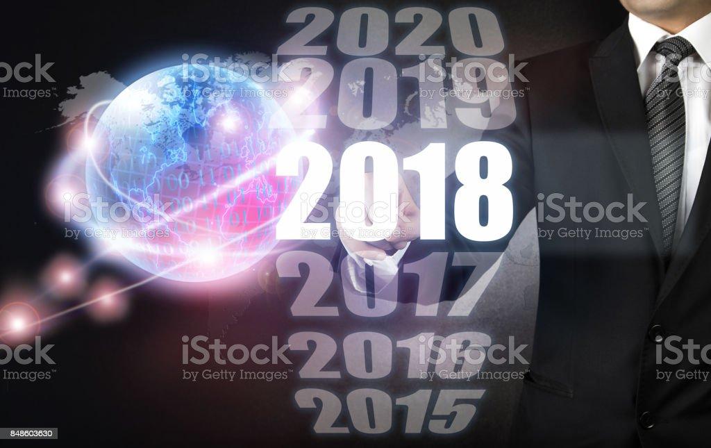 Businessman touching new year 2018 stock photo
