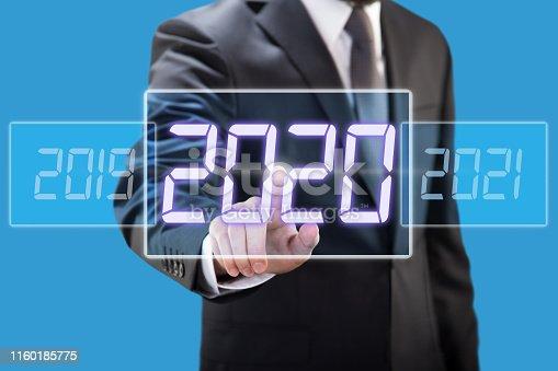 istock Businessman touching new year 2020 1160185775