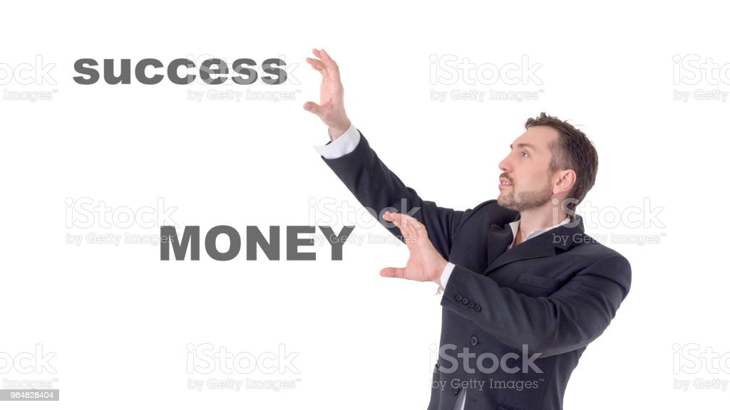 Businessman touching on air words money and success royalty-free stock photo