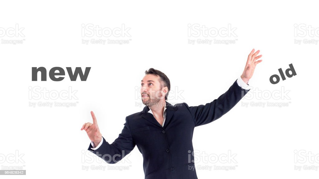 Businessman touching on air words old and new royalty-free stock photo