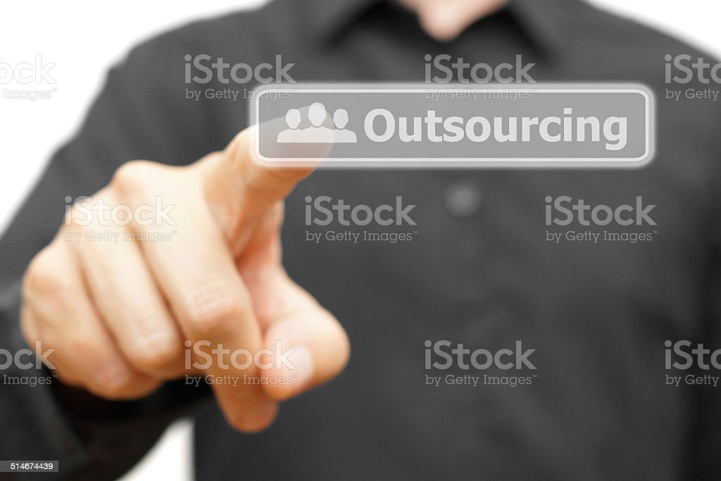 Businessman touching Outsourcing word stock photo