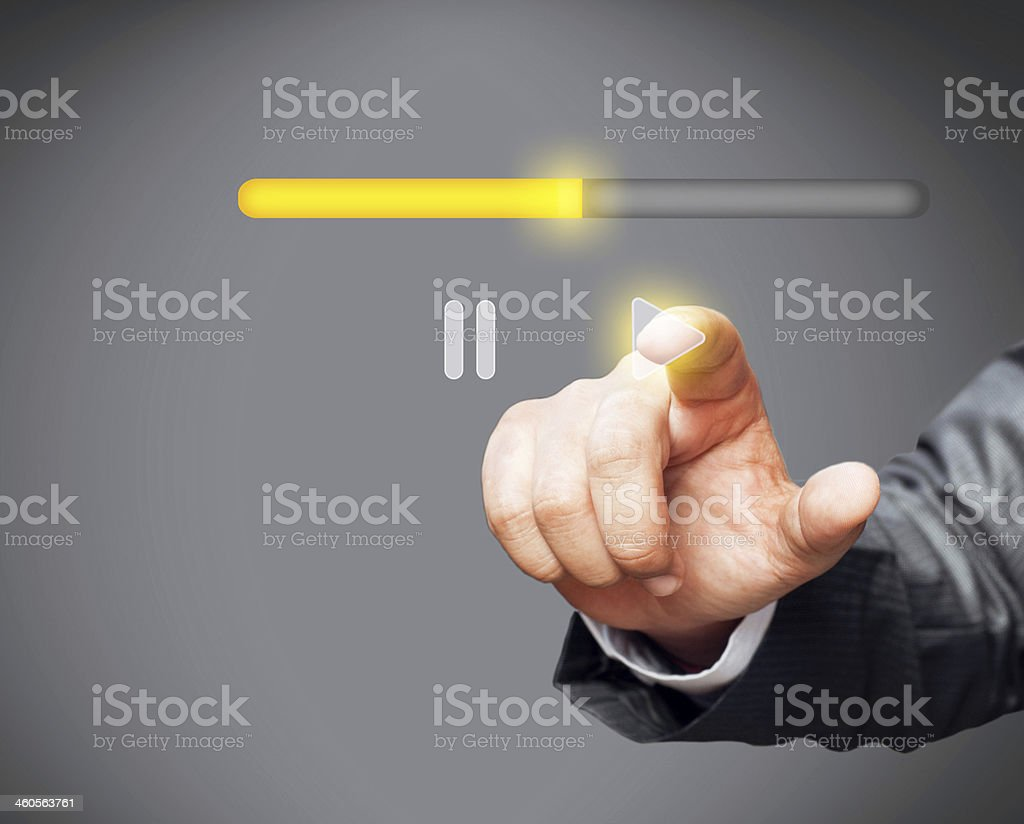 Businessman touching play icon stock photo