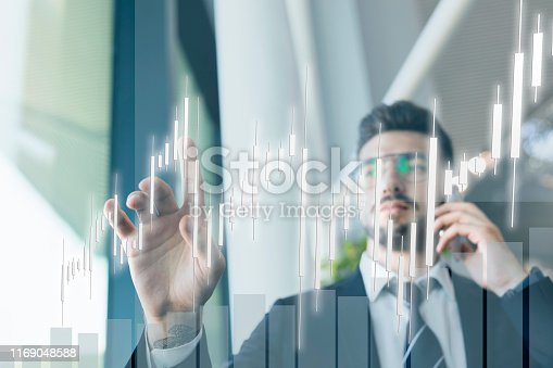 875503222 istock photo businessman touching profit on futuristic display 1169048588