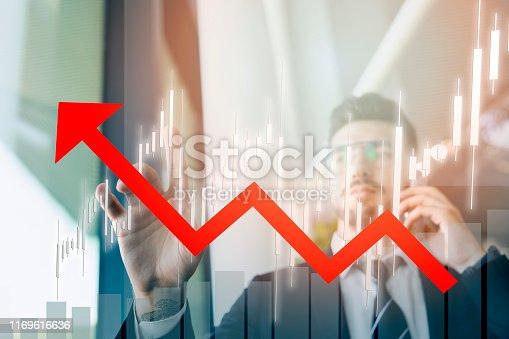 875503222 istock photo businessman touching profit on futuristic display 1169616636