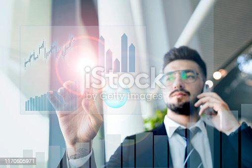 875503222 istock photo businessman touching profit on futuristic display 1170605971