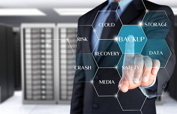 Businessman touching secure data backup on touch screen stock photo