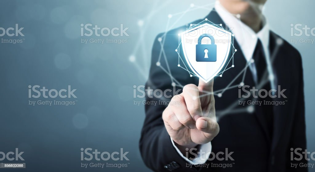Businessman touching shield protect icon, Concept cyber security safe your data Businessman touching shield protect icon, Concept cyber security safe your data Accessibility Stock Photo