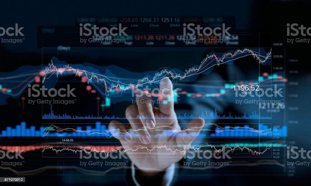 Businessman touching stock market graph on a virtual screen display. stock photo