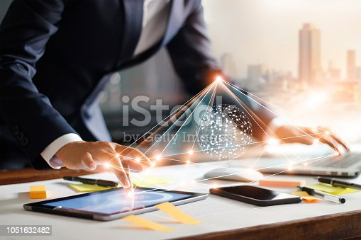 istock Businessman touching tablet and laptop. Management global structure networking and data exchanges customer connection on workplace. Business technology and digital marketing network concept. 1051632482