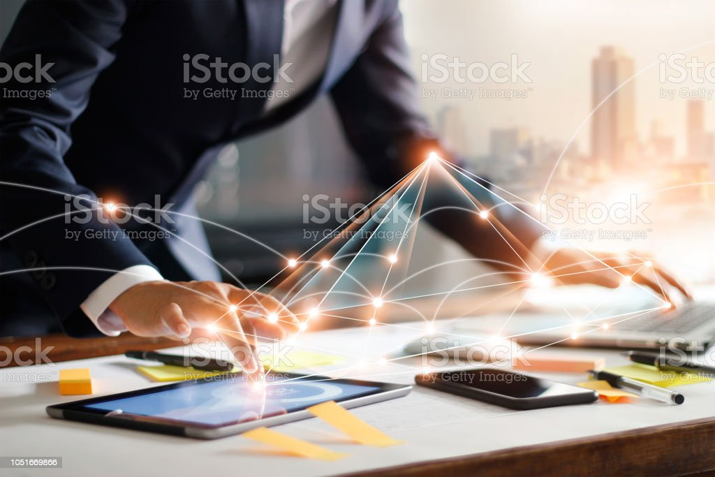 Businessman touching tablet and laptop, managing global structure networking and data exchanges customer connection on workplace. Business technology and digital marketing network concept. Businessman touching tablet and laptop, managing global structure networking and data exchanges customer connection on workplace. Business technology and digital marketing network concept. Abstract Stock Photo