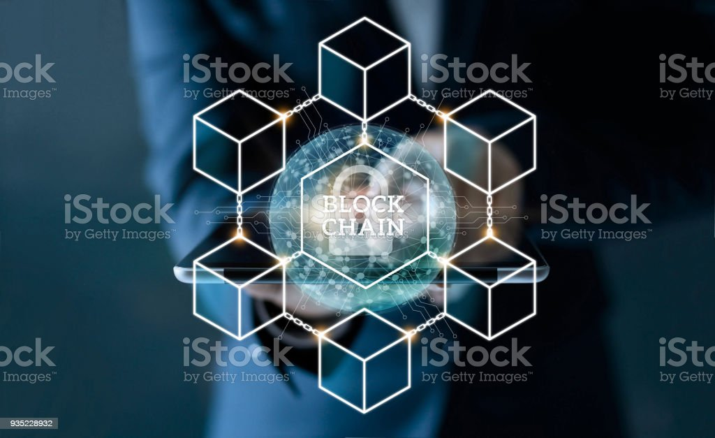 Businessman touching tablet with blockchain network connection and microcircuit icon on global virtual screen. Blockchain technology and business concept stock photo