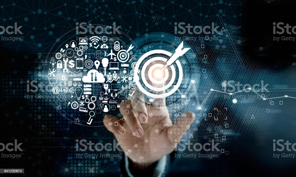 Businessman touching target with icon digital marketing on network connection background. Business innovation technology concept stock photo