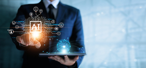 Businessman touching the brain working of Artificial Intelligence (AI) in the futuristic business and coding software development on interface and synchronize network connection, IoT, innovative and technology of business.