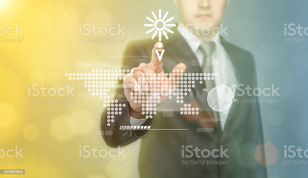 Businessman touching the digital touch screen by his finger. stock photo