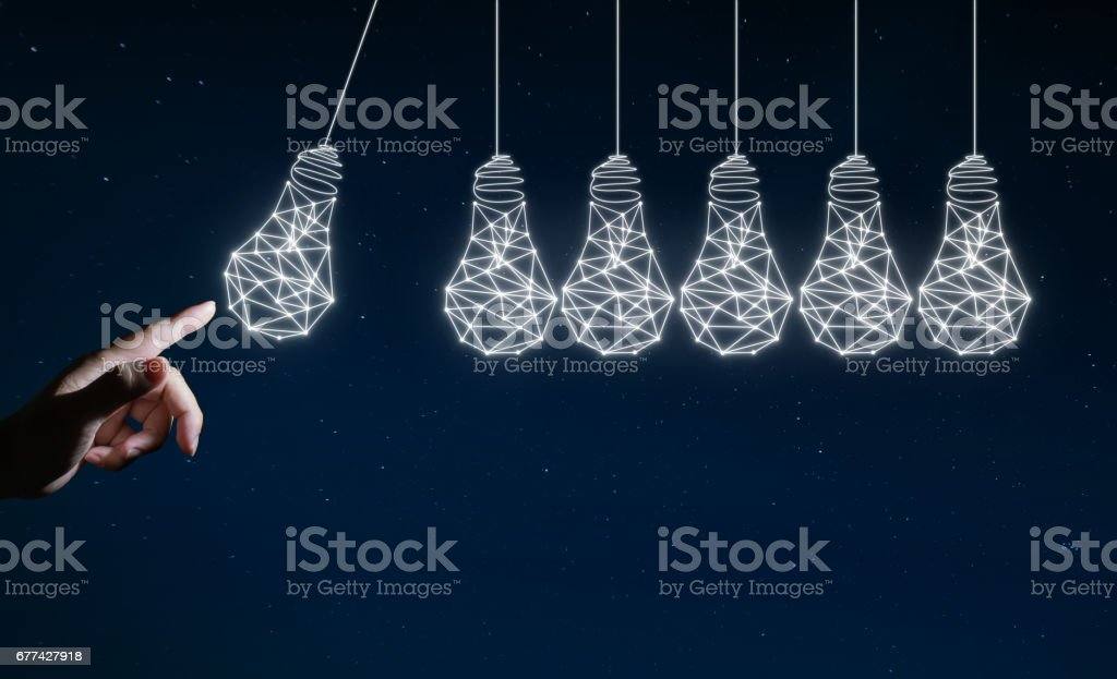 Businessman touching the idea bulb , Concept of creativity and Innovation . stock photo