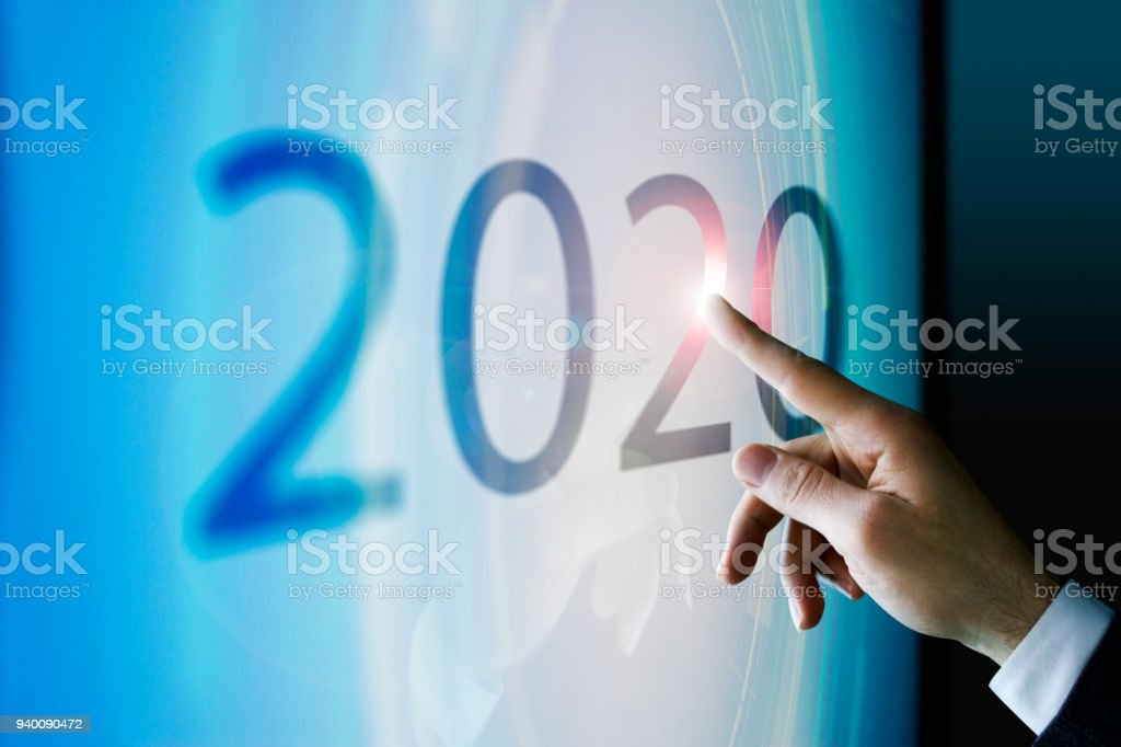 Businessman touching the screen about 2020 stock photo