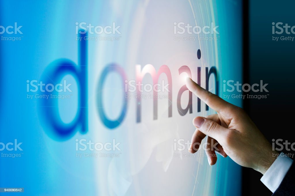 Businessman touching the screen about domain Businessman touching the screen in the office Adult Stock Photo