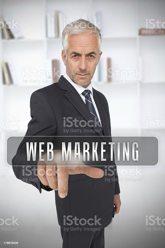 Businessman touching the term web marketing royalty-free stock photo