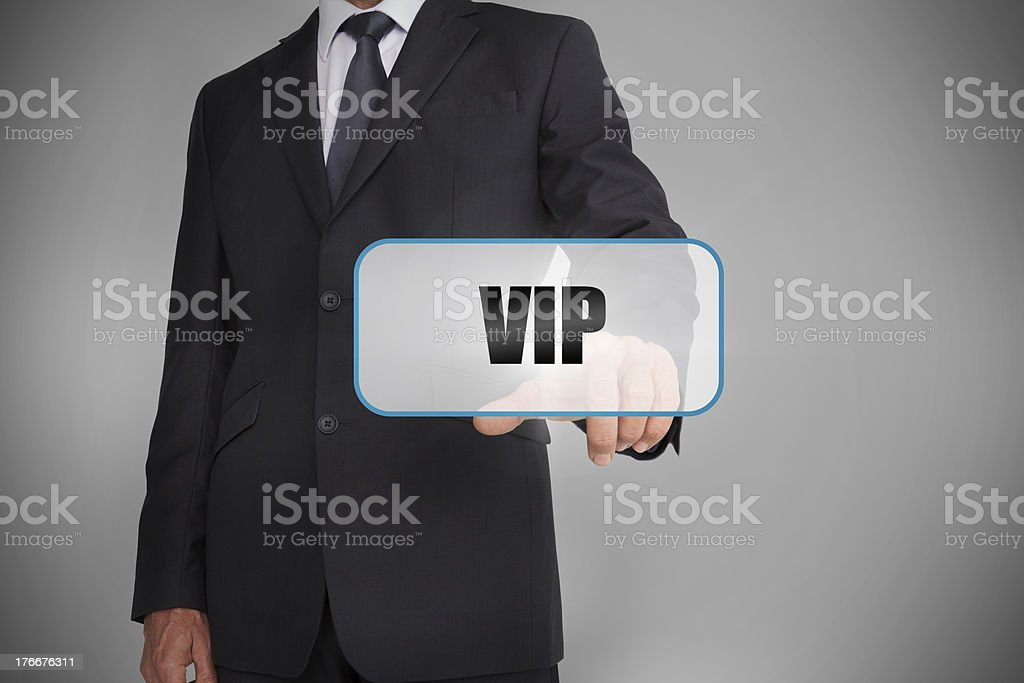 Businessman touching white tag with the word vip written on royalty-free stock photo